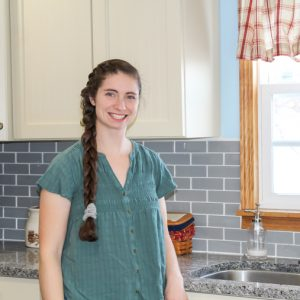 Woman standing in front of kitchen counter