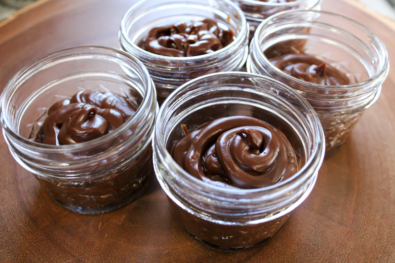 five 4oz mason jars filled with dairy free chocolate pudding