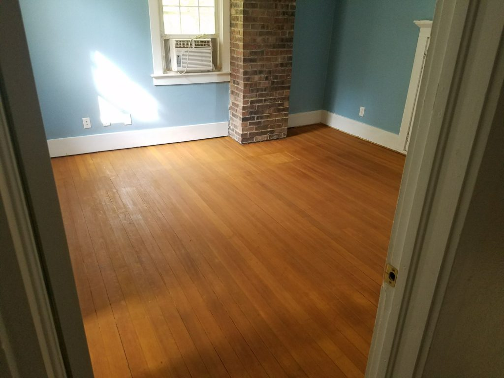 hardwood floor ready for stain in the farmhouse