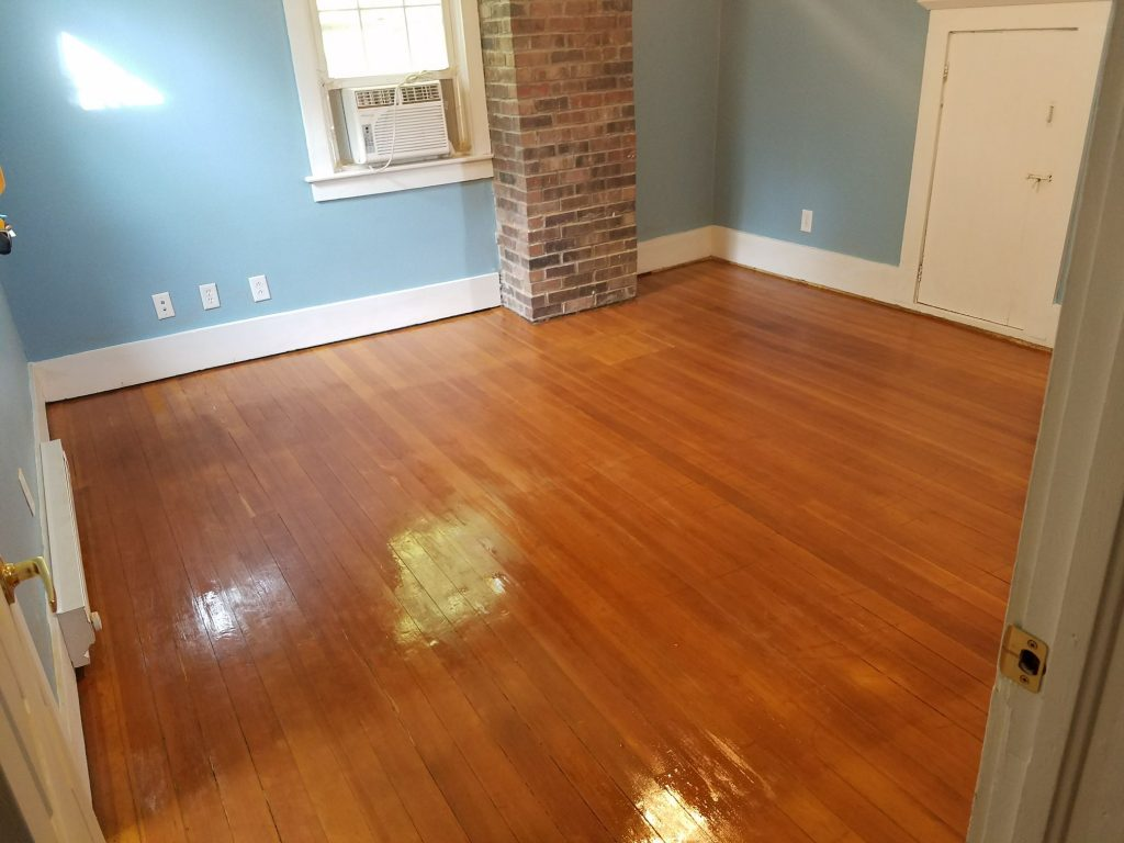 freshly stained hardwood floor in the master bedroom of the farmhouse