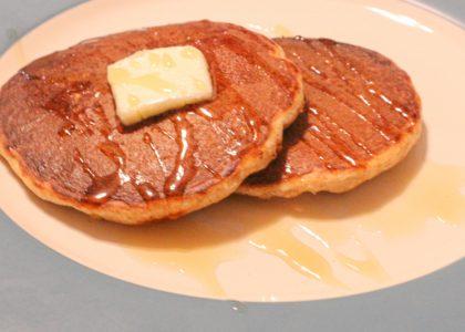 two sourdough pancakes on a plate