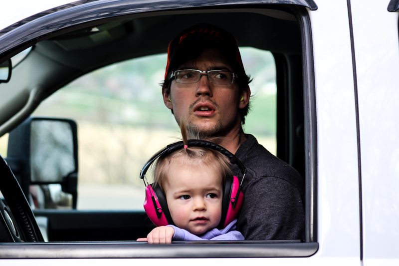 daughter and father looking out the window of a truck