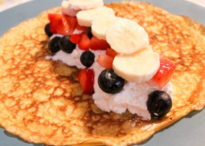sourdough crepe topped with cream and fresh fruit