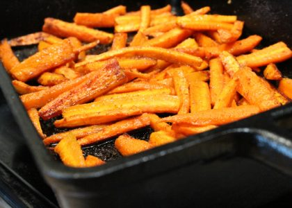 seasoned roasted carrots in a castiron pan