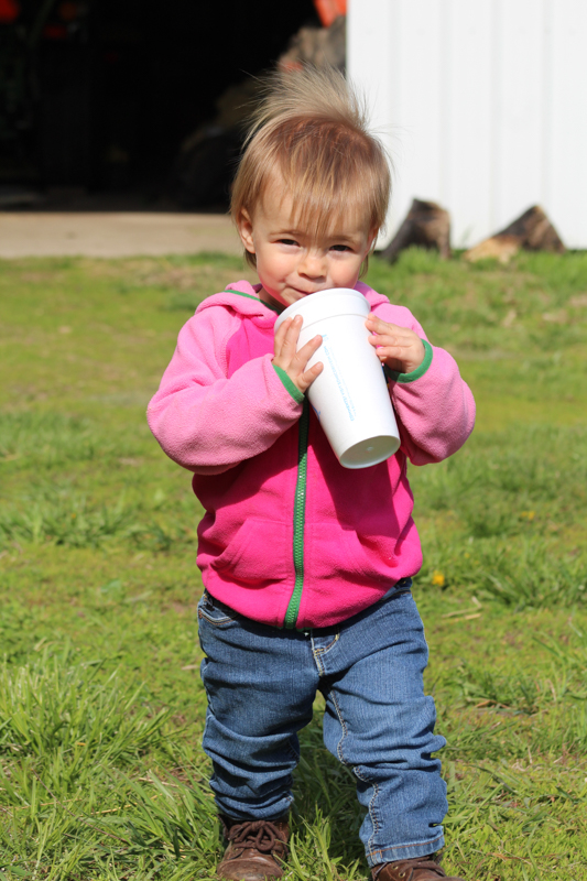 shelby drinking a slushy at the cattle farm