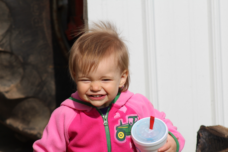 little girl smiling for the camera holding a sonic slushy