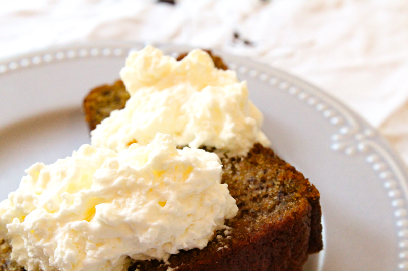 einkorn banana bread topped with whipped cream