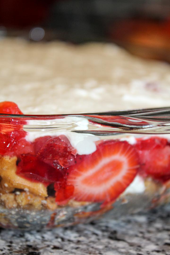 Strawberry pretzel salad desert in a glass 9x13 pan